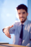 Businessman offering to shake hands stock photos