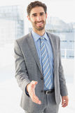 Businessman offering to shake hands Royalty Free Stock Photos
