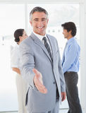 Businessman offering to shake hands Stock Images