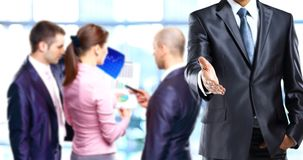 Businessman offering to shake your hand Stock Photography