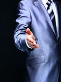 A businessman offering to shake your hand Royalty Free Stock Image