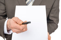 Businessman offering to sign up blank paper Stock Images