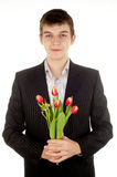 Businessman offering tulip Royalty Free Stock Photography