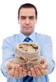 Businessman offering you a bag of money Royalty Free Stock Photography