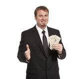 Businessman offers handshake with money Stock Photos