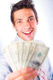 Businessman offers money, smiles. Isolated in a white background Royalty Free Stock Photos