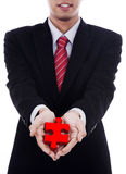 Businessman Offers a Puzzle Royalty Free Stock Images