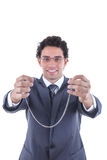 Businessman offers a silver necklace Royalty Free Stock Image
