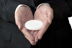 Businessman Offers White Concept Stone Stock Photography