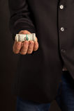 Businessman offers you money Stock Photo