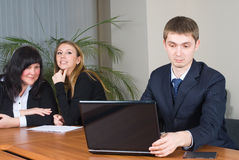 Businessman in office. Businessman leading team of business people working in background Stock Photography