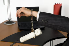 Businessman in office. Business man tied to the phone Royalty Free Stock Photos