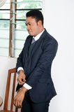 Businessman at the office. This businessman is being well arrange the sleeve of his suit Stock Photos