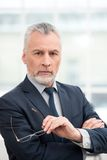 Businessman in office with big window Stock Photos