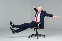 Businessman in office chair Royalty Free Stock Photo