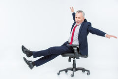 Businessman in office chair Royalty Free Stock Images