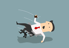 Businessman in an office chair falls backwards Stock Images
