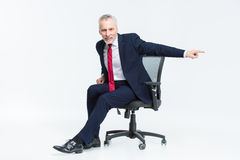 Businessman in office chair Stock Image
