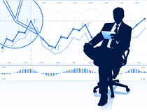 Businessman in office chair Royalty Free Stock Image