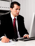 Businessman in office with computer royalty free stock photos