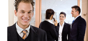 Businessman on office corridor Stock Photo