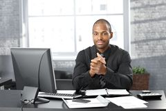 Businessman at office desk Stock Images