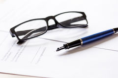 Businessman office desk with contract for signig, glasses and pen Royalty Free Stock Photography