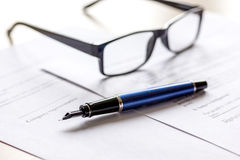 Businessman office desk with contract for signig, glasses and pen Stock Photos