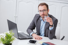 Businessman at the office desk stock image
