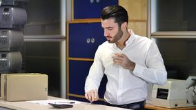Businessman in office drinking coffee while working stock video footage