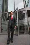 Businessman at office exterior Royalty Free Stock Images