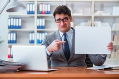 The businessman  in office holding a blank message board Stock Photography