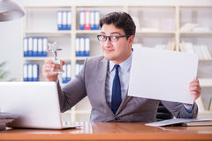The businessman  in office holding a blank message board Stock Photos