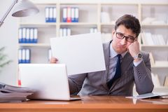 The businessman  in office holding a blank message board Royalty Free Stock Photo