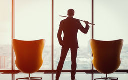 Businessman in office holding katana Stock Images