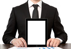 Businessman in office holding tablet with isolated screen Stock Photography
