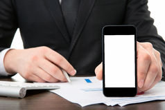 Businessman at the office holding a touch phone with isolated sc Stock Images