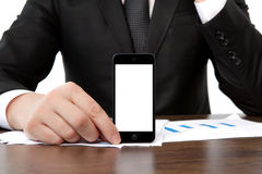 Businessman at the office holding a touch phone with isolated sc Royalty Free Stock Photography