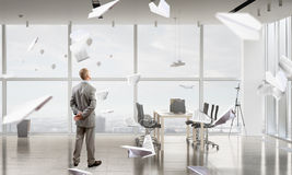 Businessman in office interior Royalty Free Stock Photography