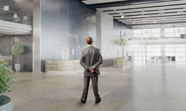 Businessman in office interior Royalty Free Stock Images