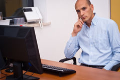 Businessman in office. Manager businessman sitting in office Stock Images