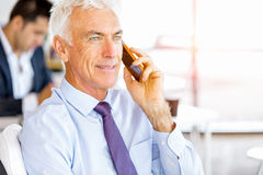 Businessman at the office with mobile phone Royalty Free Stock Photo