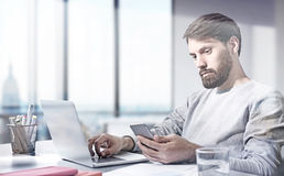 Businessman in office NYC view Stock Image
