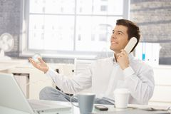 Businessman in office on phone call Stock Images