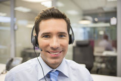 Businessman in the office on the phone with headset Royalty Free Stock Photo
