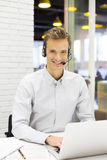 Businessman in the office on the phone with headset, Skype Royalty Free Stock Photography