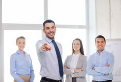 Businessman in office pointing finger at you Stock Image