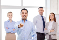 Businessman in office pointing finger at you Royalty Free Stock Photo