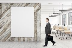 Businessman in office with poster Royalty Free Stock Images