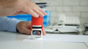 Businessman in Office Room Stamping Official Company Documents and Contracts.  stock image